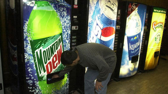 A University of Illinois-Chicago student buys a bottle of pop at the UIC student center in a 2003 file photo.