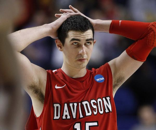 Davidson forward Jake Cohen wasn't happy to lose to Marquette in the NCAA college basketball tournament, but the Davidson College math majors are doing well in picking the brackets for the Sweet 16.