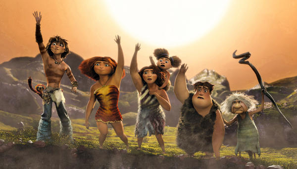"This film publicity image released by DreamWorks Animation shows, from left, Belt the sloth, voiced by Chris Sanders, Guy, voiced by Ryan Reynolds, Eep, voiced by Emma Stone, Ugga, voiced by Catherine Keener, holding Sandy, voiced by Randy Thom, Thunk, voiced by Clark Duke, Gran, voiced by Cloris Leachman, in a scene from ""The Croods."" (AP Photo/DreamWorks Animation)"