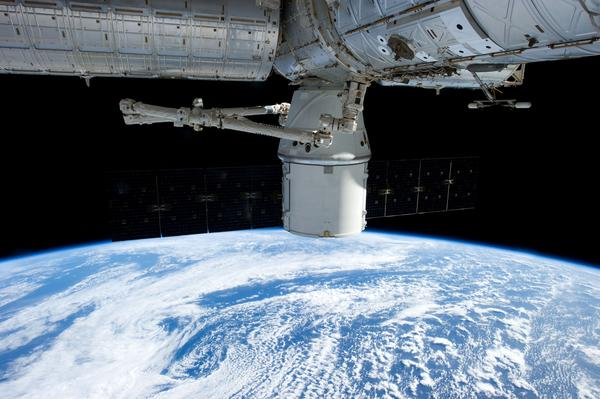 SpaceX's Dragon capsule is attached to the International Space Station during the resupply mission.