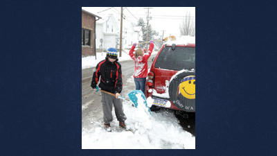 Tristan Hummel, 10, and her brother Seth Philips, 12, had a busy day shoveling for relatives and having a few friendly snow fights in between jobs (see video on dailyamerican.com). The two children of Laci Hummel shoveled out their grandmother before showing up on Sanner Street in Somerset to remove the snow from around their uncles vehicle.