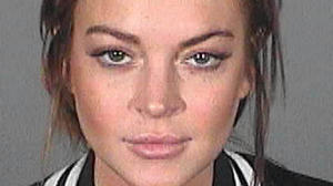 Lindsay Lohan parties through weekend but gets to work on time
