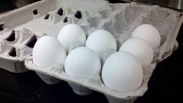 Store your eggs in their carton toward the back of the refrigerator.