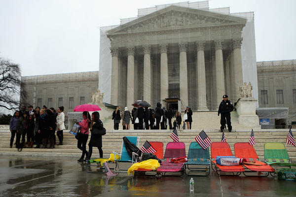 Demonstrators set up beach chairs in front of the U.S. Supreme Court in Washington, D.C., where dozens of people waited in line Monday for a chance to attend oral arguments Tuesday over the constitutionality of Proposition 8.