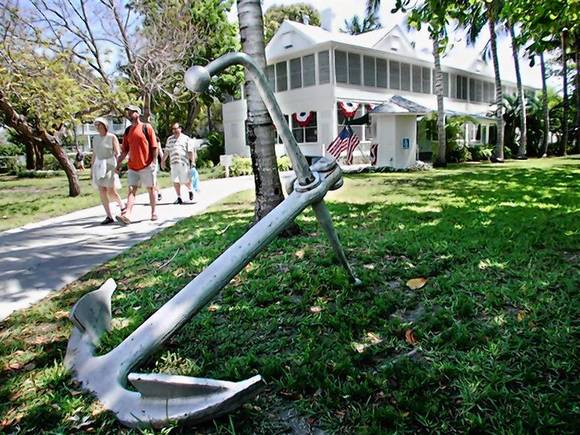 Visitors stroll outside the Harry S. Truman Little White House Museum in Key West
