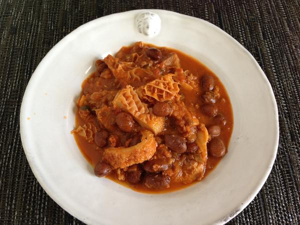 Tripe simmered in tomato with pancetta and borlotti beans.