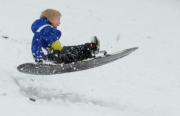 Brody Thomas, 3, of Hagerstown gets his sled airborne as he slides down a hill at Fairgrounds Park on Monday.