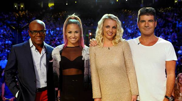 """The X Factor"" judges from last season are, from left, L.A. Reid, Demi Lovato, Britney Spears and Simon Cowell."