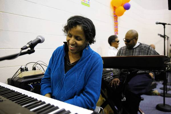 Victoria Johnson-Gore, left, leads the all-blind band VisionQuest at an Illinois Center for Rehabilitation and Education commencement.