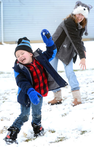 4-year-old Brayden Campbell of Martinsburg, W.Va., tried to dodge the snowball thrown by his mother Brittany Burdette Monday afternoon but wasn't fast enough. Monday's snow quickly turned to rain in the Tri-State and much of it melted before sunset.