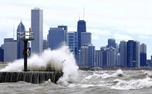 Waves from a choppy Lake Michigan crash into the lakefront near the 39th Street Beach early Monday. Chicago escaped the snow-packed punch of a winter storm that dumped several inches on central and southern Illinois on Sunday.
