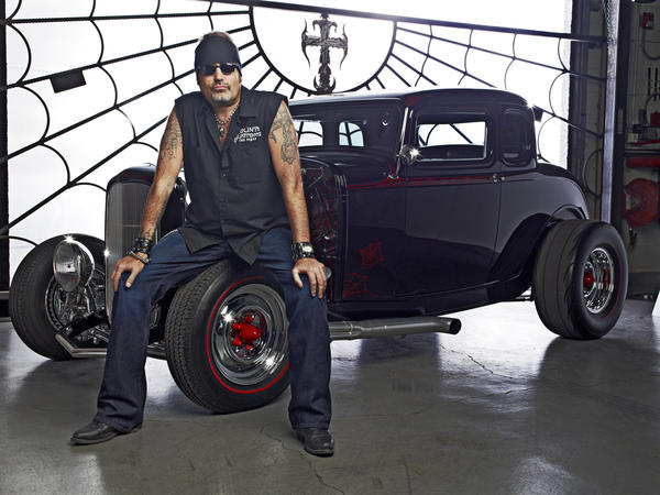 "Danny ""The Count"" Koker poses in front of one of the many vintage vehicles he has restored. His Las Vegas garage is the site of filming for the History Channel's ""Counting Cars."""