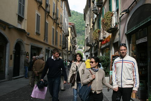 Visitors walk the streets of Como, located at the western terminus of Lake Como, the lake's largest town. Attractions include a funicular, cathedral, villas and museums.