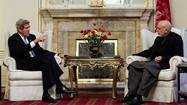 U.S. Secretary of State John Kerry meets with Afghanistan's President Hamid Karzai at the Presidential Palace in Kabul