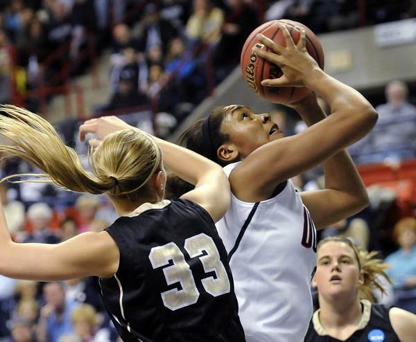 UConn forward Morgan Tuck goes for a layup around Idaho Vandals guard/forward Alyssa Charlston (33) in a first-round NCAA Tournament game at Gampel Pavilion. Tuck scored a career-high 18 points in UConn's 105-37 win.