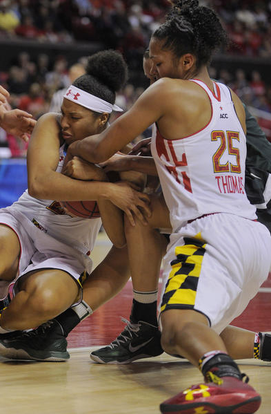 Maryland's Tianna Hawkins and Alyssa Thomas (right) fight with Michigan State's Klarissa Bell for the ball during first half action.