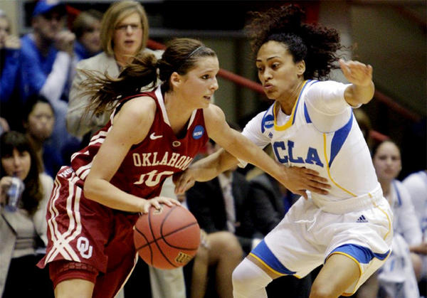 Oklahoma's Morgan Hook, left, dribbles upcourt as UCLA's Mariah Williams defends during the first half.
