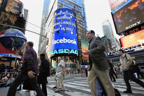 Facebook is listed on the Nasdaq stock exchange as shown on the board in New York's Times Square during the company's IPO.