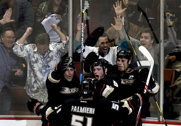 Fans and Ducks teammates celebrate a game-tying goal against the Chicago Blackhawks.