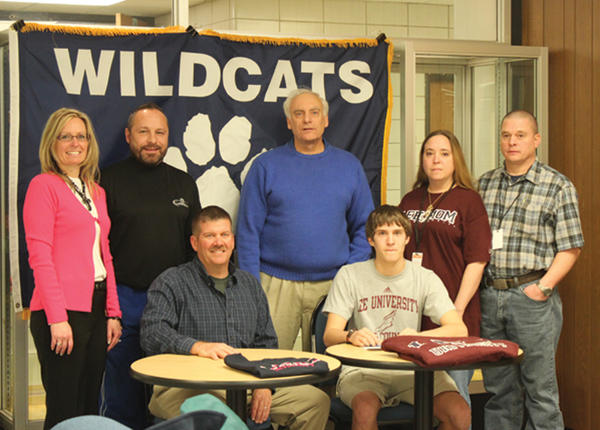 Williamsport senior Austin Schetrompf, seated right, recently signed a letter of intent to continue his track and cross country career at Lee University in Cleveland, Tenn. Sitting next to him is his father, Gary Schetrompf. Standing, from left to right, are his stepmother, Cathy Schetrompf, associate pastor Kevin Smoot, Williamsport cross country coach Randy Buchman, his mother, Sandy Zimmerman, and his stepfather, Steve Zimmerman. Schetrompf was an All-Washington County first-team cross country runner last fall. Lee University competes in the NAIA and is a member of the Southern States Athletic Conference.