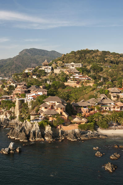 Hillside houses reflect the iconic look of Zihuatanejo, Mexico.