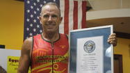 When it comes to setting Guinness World Records, ultra-endurance athlete George Hood of Aurora has done it in a variety of ways: unofficially, officially, and officially while in support of a most worthy charitable cause.