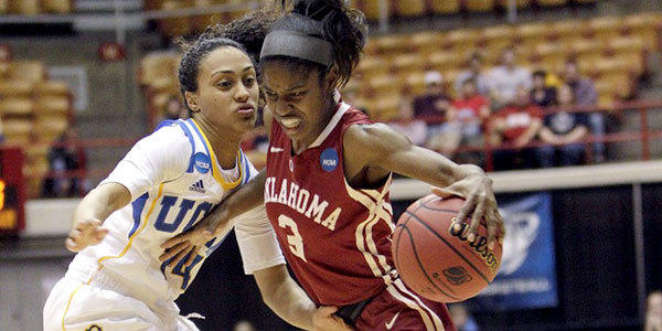 Oklahoma's Aaryn Ellenberg brings the ball up court as UCLA's Mariah Williams defends during the Sooners' NCAA tournament victory over the Bruins, 85-72.