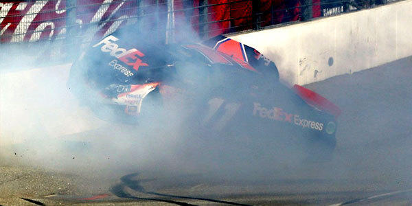 Denny Hamlin suffered a broken back during a crash at Fontana during the Auto Club 400 on Sunday.