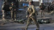 KABUL, Afghanistan -- A team of eight suicide bombers stormed a police compound in the eastern Afghan city of Jalalabad on Tuesday, killing five police officers and injuring four others, a provincial police chief said.
