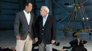 Tiger Woods and Arnold Palmer in 'The Rumble'