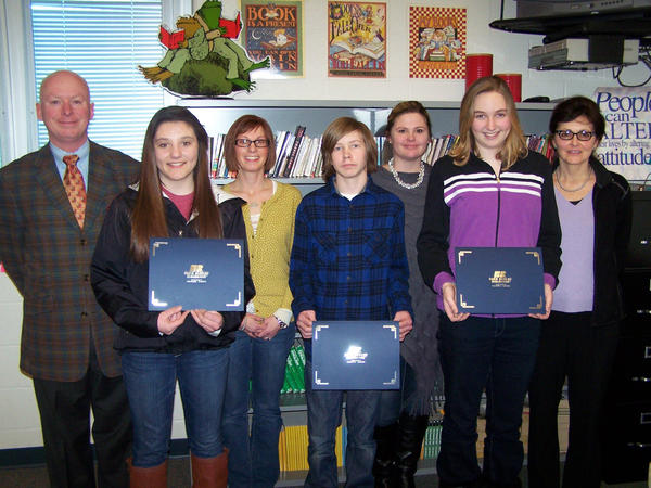 John M. Crinnion Farm Bureau Insurance agent (from left) presents awards at Harbor Springs Middle School to Elena Esposito first place, Megan McShannock eighth-grade teacher, Noah Bassett second place, Ellen Roberts eighth-grade teacher, Libby Garver third place and Monica Graham eighth-grade teacher.