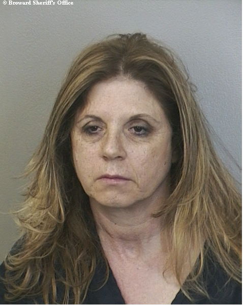 Hollywood woman arrested after allegedly doing donuts at a Davie intersection in a Jeep missing a wheel.