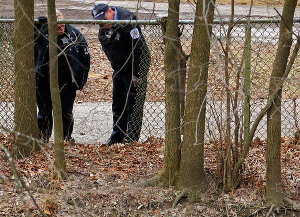 Chicago Police look at a body in the north branch of the Chicago River while they wait for a water recovery team on Tuesday morning.