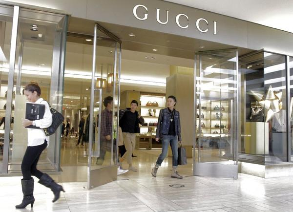 Shoppers outside Gucci store at South Coast Plaza in Costa Mesa. Consumer spending accounts for about 70% of the economy.