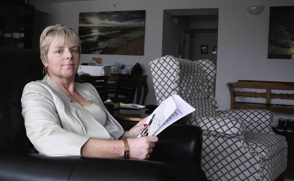 PJ Newberg, an anti-heroin advocate, goes over heroin studies on March 25 in her Skokie home. She will speak at the Glenview Public Library on March 28 at 7 p.m. about the dangers of heroin.