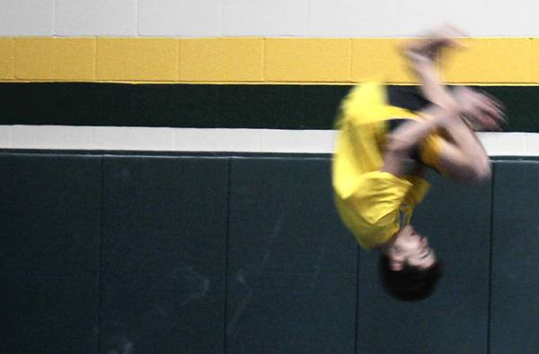 Glenbrook North High School junior Sean Killian does a flip during a parkour session, which was a part of Spartans Connect day on March 20.