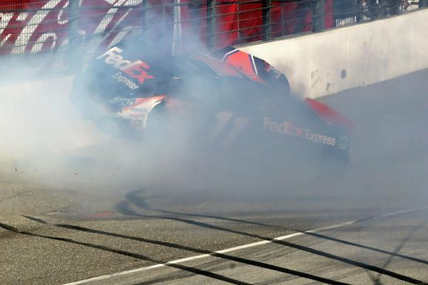 NASCAR driver Denny Hamlin suffered a compression fracture in his back Sunday when he crashed into a wall on the final lap at Fontana.