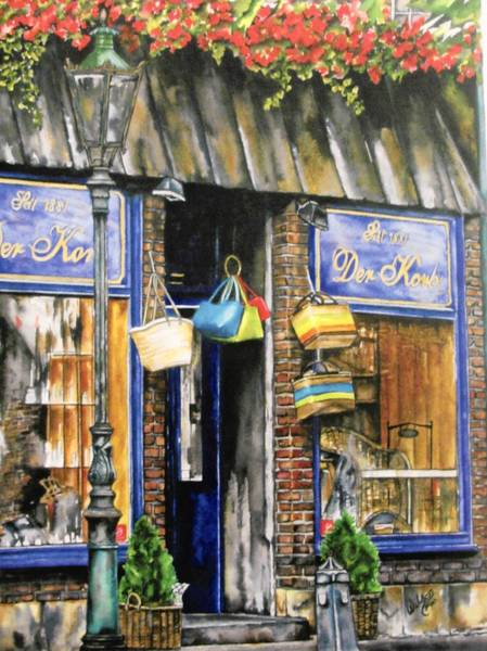"""Bag and Baggage,"" a water color painting of storefront windows in Amsterdam by artist Carole Wilson."