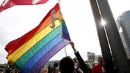 The crowd cheered and clapped Tuesday morning as the LGBT pride flag was raised and flapped for the first time over City Hall Plaza in Long Beach.