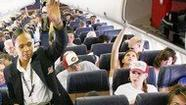 If you find an empty seat next to you on your next flight, consider yourself very lucky.
