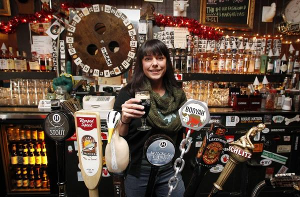 Beer fan Holly DeShaw serves 80 craft brews at a Milwaukee bar she opened in 2008.