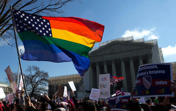 Equal rights supporters demonstrate in front of the U.S. Supreme Court, which is hearing arguments on California's Proposition 8.