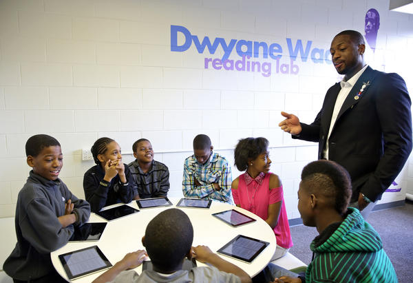 Dwyane Wade talks with students at By the Hand Club for Kids on Tuesday in Chicago.