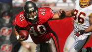 Mike Alstott, who played fullback for the Tampa Bay Buccaneers, is now the football coach at St. Petersburg Northside Christian. (Gary W. Green, Orlando Sentinel)