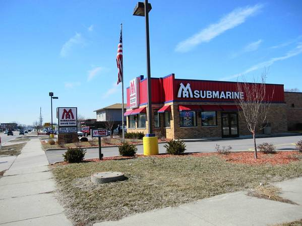 Village officials often cite Mr. Submarine at 1322 Ogden Avenue, previously a vacant building, as a positive example of its strategy to improve the look of the roadway.
