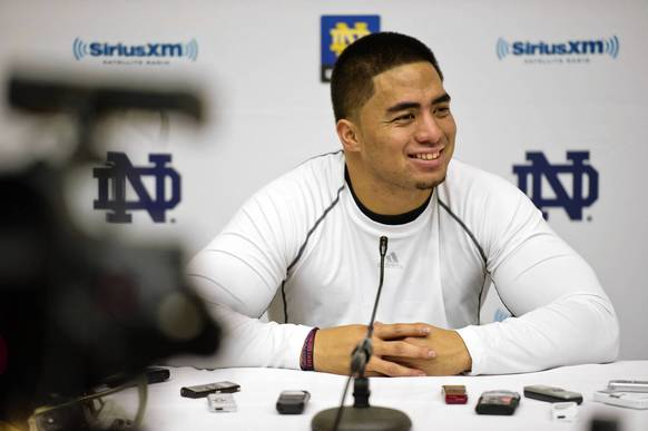 Manti Te'o answers questions at a news conference.