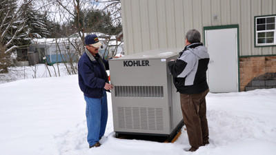 Addison Volunteer Fire Department Chief Gary Compton shows Rick Lohr, Emergency Management Agency executive director, a generator that was purchased for the fire hall. Firefighters plan to turn the hall into an emergency shelter for southern Somerset County.