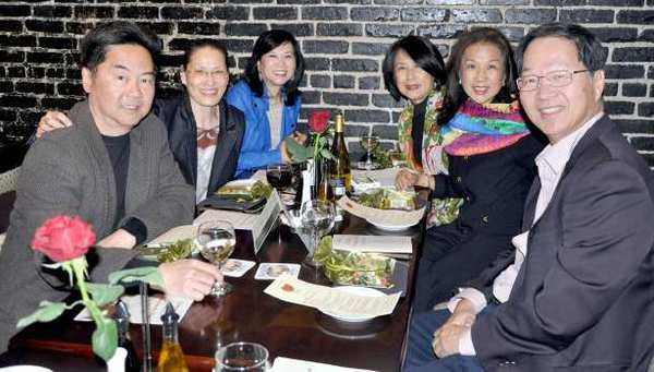 "Dining with a lot of heart at a benefit called ""Dinners from the Heart"" at Cucina Rustica Restaurant in Montrose are (left, around the table) Teffy Mang, Julie Mang, Beatrice Li, Janet Ho, Kimmie Leung and Hok Leung."