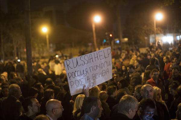 Russians living in Cyprus join in demonstrations outside the Cypriot parliament in Nicosia on March 21, urging Moscow's help in staving off Cypriot government seizure of private bank deposits to secure a Eurozone bailout.