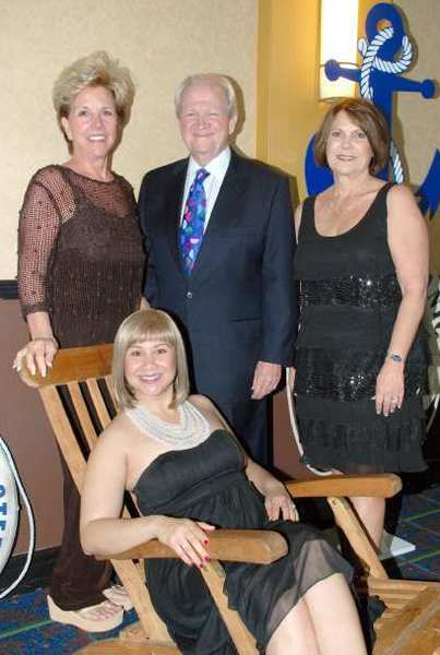 "It was all hands on deck for Gary Olson, his wife, Sharon, left, and chamber staffers, Sheri Rang, right, and Kimberly Thompson, seated, for Fridays ""Anchors Aweigh!"" gala."